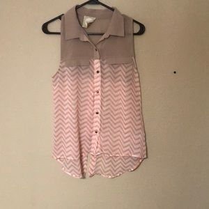 Peach and tan colored sleeveless button up shirt